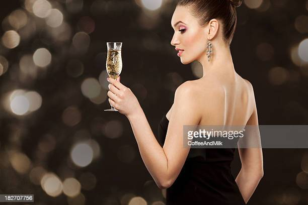Young sexy woman with a cocktail