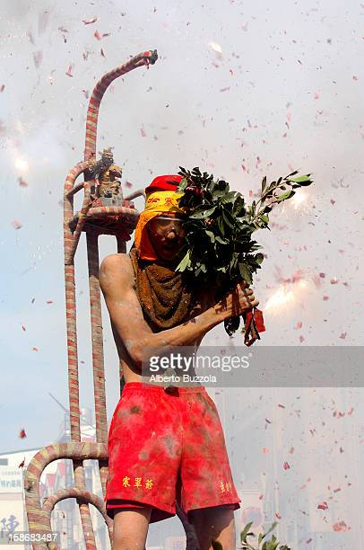 A young shaman standing on a sedan chair takes part in the annual festival in honor of the God Handan According to traditions the cold fearing God is...