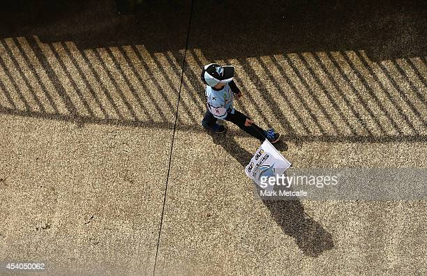 A young Sharks fan walks inside the stadium before the round 24 NRL match between the Cronulla Sharks and the Canberra Raiders at Remondis Stadium on...