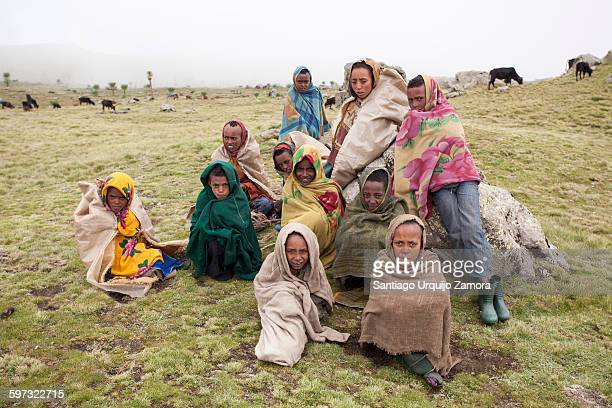 Young shepherds huddled together in Simien Mountains, Ethiopian Highlands, Amhara, Ethiopia