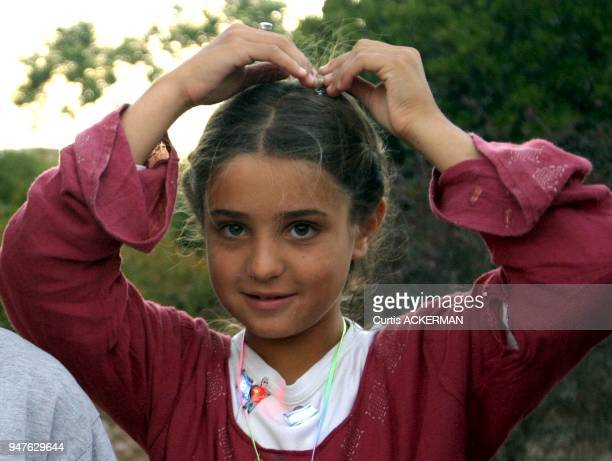 A young Shilo settler girl at a community event Shilo is a large West Bank settlement located north of Jerusalem was once a capital of the ancient...