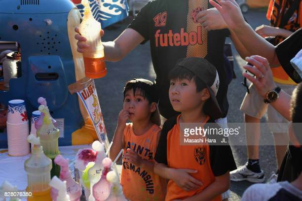 Young Shimizu SPulse supporters wait for shaved ice priro to the JLeague J1 match between Shimizu SPulse and Cerezo Osaka at IAI Stadium Nihondaira...