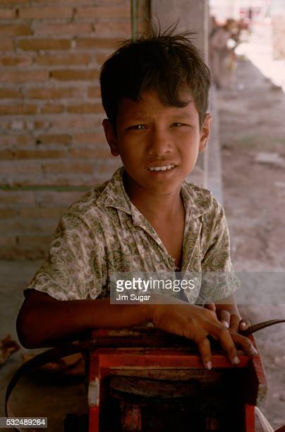 Young Shoe Shiner Holding Stool