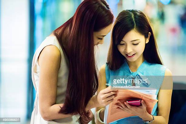 Young shopaholic women signing up for credit card