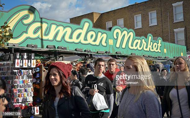 Young shoppers hit the world famous Camden Market on a sunny Saturday afternoon in September Camden North London England September 2012