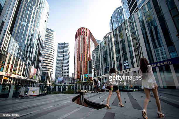 Young shoppers in Sanlitun soho a new complex of office shopping and entertainment centers located opposite to Sanlitun Tai Koo Li According to...