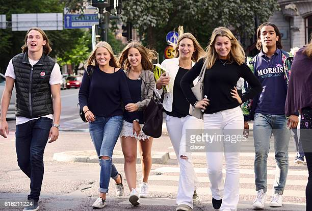 Young shopping school girls walking down the street