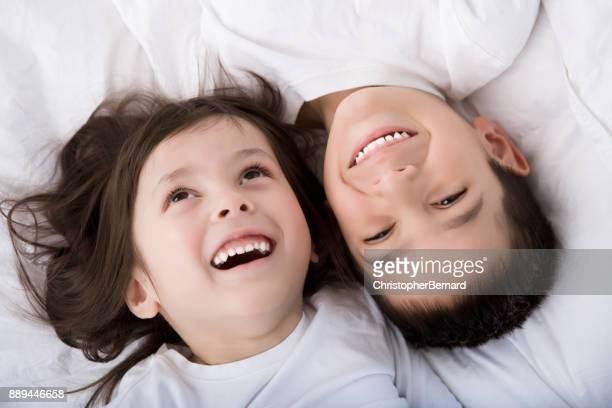 Young sibling bedroom portrait