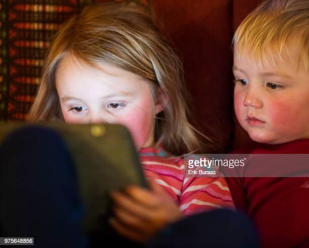Young siblings sharing a digital tablet
