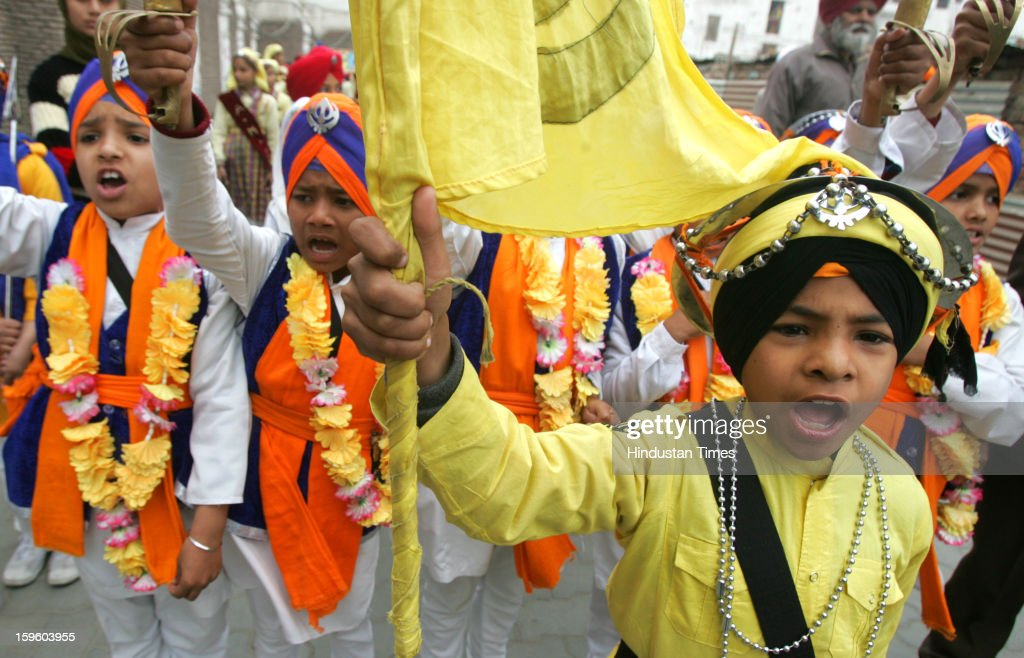 Young Sikh children dressed as Panj Pyare raising slogans while taking part in a religious procession on the eve of Birth Anniversary of 10th Sikh Guru Gobind Singh Ji, on January 17, 2013 in Amritsar, India. Guru Gobind Singh Ji was 10th and the last of the living Sikh Gurus who founded the Sikh Khalsa in 1699.