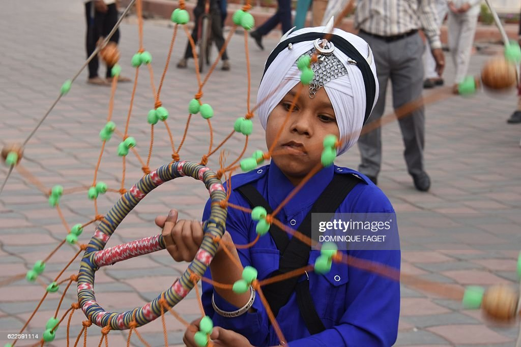 A young Sikh devotee performs Gatka at the Golden Temple in Amritsar on November 12 on the eve of the 547th birth anniversary of Sri Guru Nanak Guru..