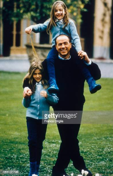 A young Silvio Berlusconi in the garden of his villa near Milan with his daughters Barbara and Eleonora whom he had from his second wife Veronica...