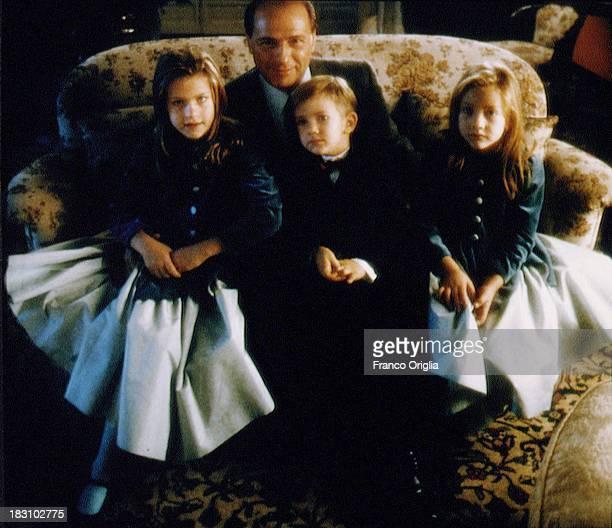 A young Silvio Berlusconi with his children Barbara Luigi and Eleonora in his villa near Milan in 1994 ca in Milan Italy