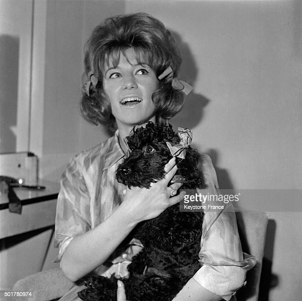 Young singer Sheila presents her new poodle hairstyle with bunches on June 10 1963 in Paris France