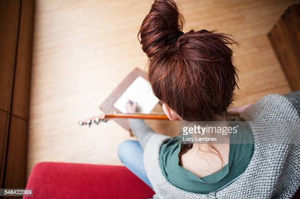 Young singer songwriter writing a song