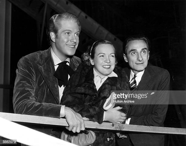 Young singerstarlet Eadie Adams visits Nelson Eddy on the MGM set of 'Maytime' The man on the right is his music teacher Dr Edouard Lippe