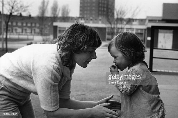 Young single mother and her child living on a housing estate in Middlesbrough, circa 1984.