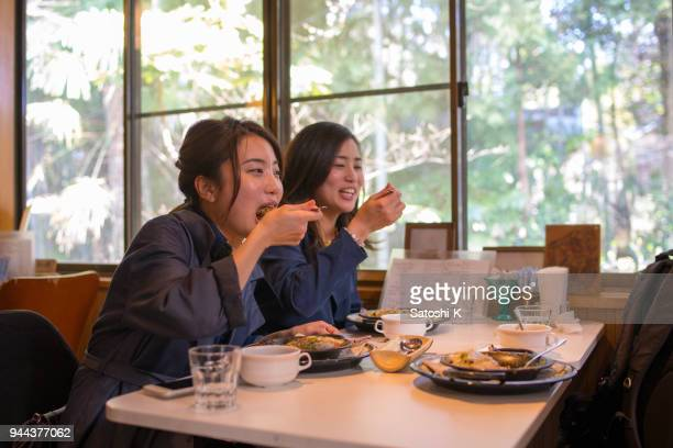 young sisters eating curry for lunch - curry meal stock pictures, royalty-free photos & images