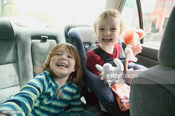 Young Sisters in Car Laughing