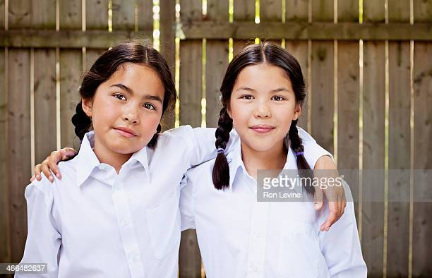 Young sistersYoung girl in white blouse and braids