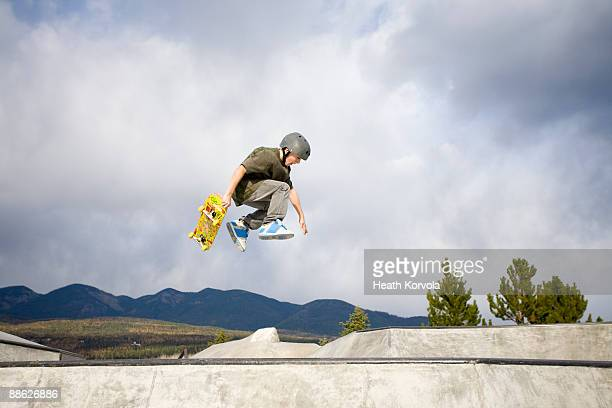 A young skateboarder catches some air.