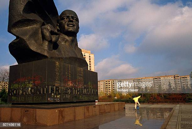 A young skateboarder leaps into the air beneath the huge memorial to the German Communist leader Ernst Thalmann the leader of the Communist Party of...