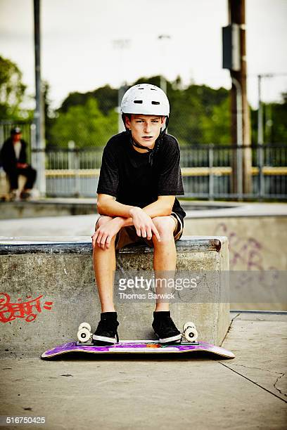 Young skateboarder with helmet in skate park