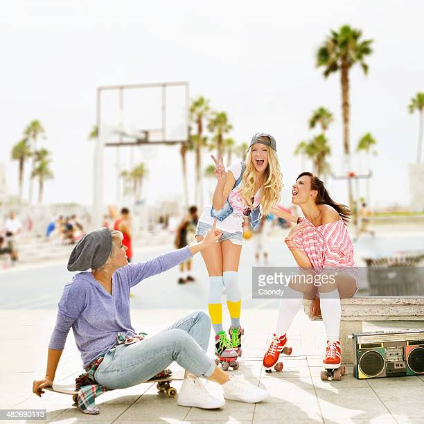Young skater girls hanging out on Venice Beach