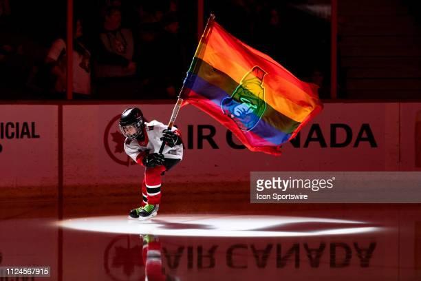 Young skater skates with the Ottawa Senators LGBT pride flag before National Hockey League action between the Carolina Hurricanes and Ottawa Senators...