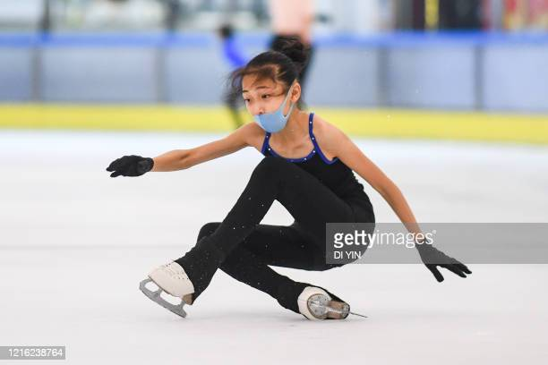Young skaters act during a training session with protective masks on May 29 2020 in Beijing China A free figure skating class was held in an ice...