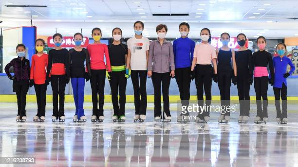 Young skaters took group photo during a training session with protective masks on May 29 2020 in Beijing China A free figure skating class was held...
