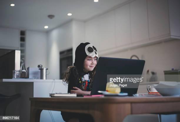 Young Skeleton Girl using laptop
