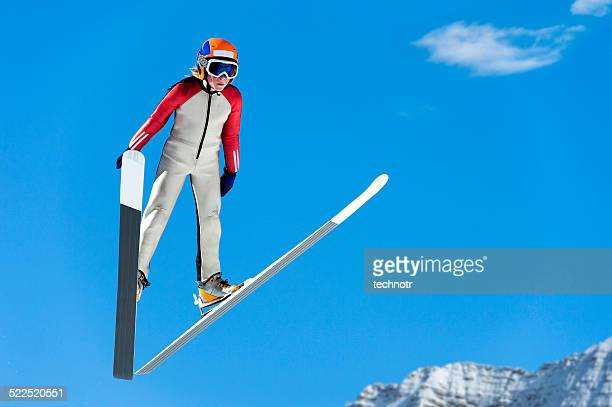 young ski jumper in mid-air against the blue sky - ski jumping stock pictures, royalty-free photos & images