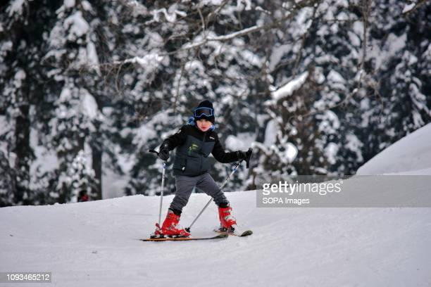 A young skier seen in action at a famous ski resort in Gulmarg about 55kms from Srinagar Indian administered Kashmir Gulmarg situated in the...