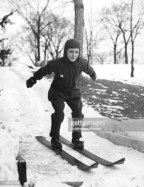 Young skier shows off her form on a jump at the Exmoor Country Club, Highland Park, Illinois, c. 1928.