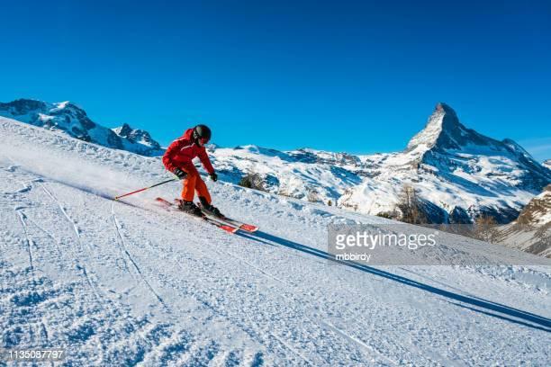 young skier skiing at zermatt ski resort, switzerland - zermatt stock pictures, royalty-free photos & images