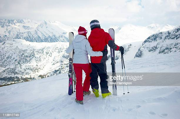Young Skiing Couple Looking Over Bansko Mountains