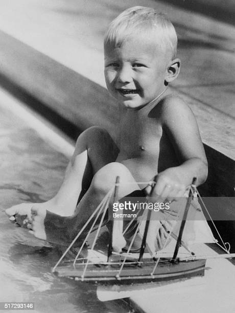 A Young Skipper Buzz Aldrin of Montclair NJ tries the water for temperature before setting sail at Miami Beach Fla where his parents are spending a...