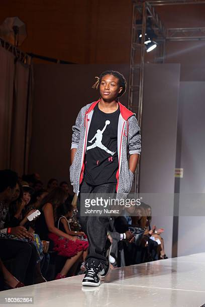 Young Slade walks the runway at the Kids Rock Celebrity Fashion Show at Grand Central Terminal on September 11 2013 in New York City