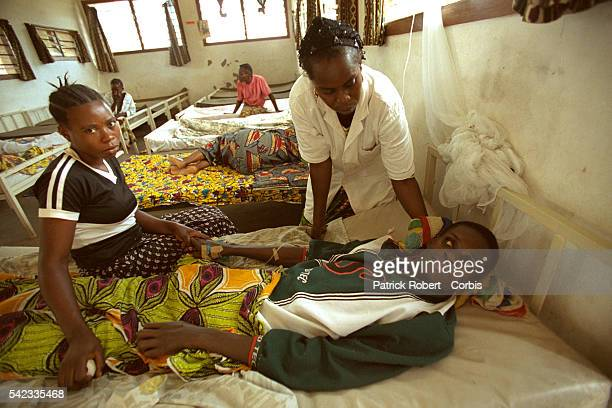 Young sleeping sickness sufferer in comatose state the disease leads to physical and behavioral problems seizures mood changes violent anger in...