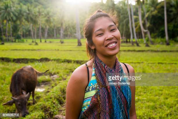young smiley asian woman looking at camera in a rural scene - filipino culture stock pictures, royalty-free photos & images