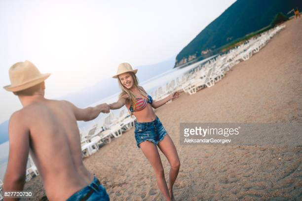 young smiling couple dancing in beach in summer - rumba stock photos and pictures