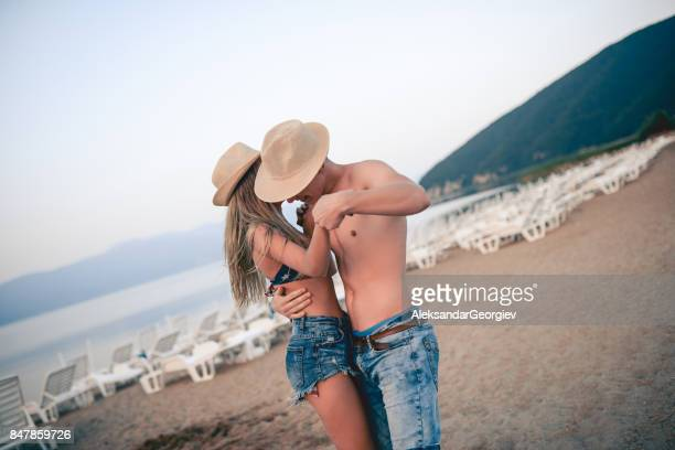 Young Smiling Couple Dancing in Beach in Summer