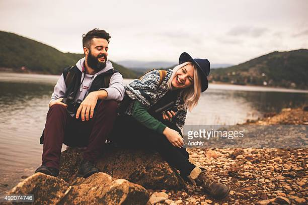 young smiling couple enjoying nature and their hiking together - outdoor pursuit stock pictures, royalty-free photos & images