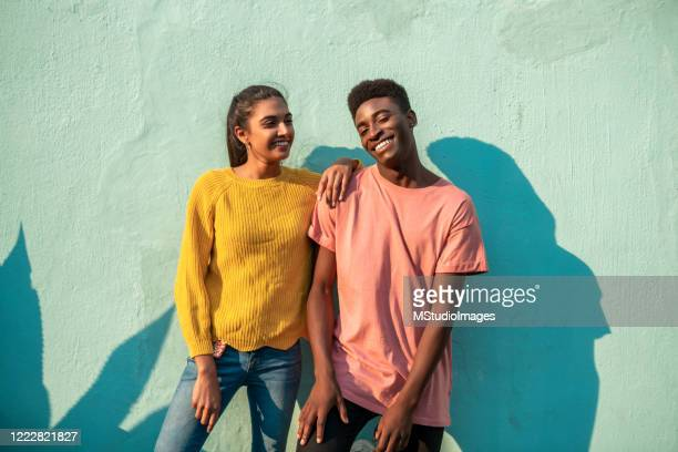 young smiling couple. - fashionable stock pictures, royalty-free photos & images
