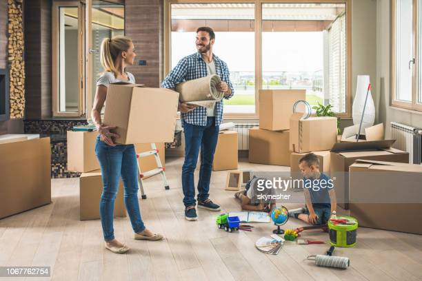 young smiling family moving into a new apartment. - penthouse girls stock pictures, royalty-free photos & images