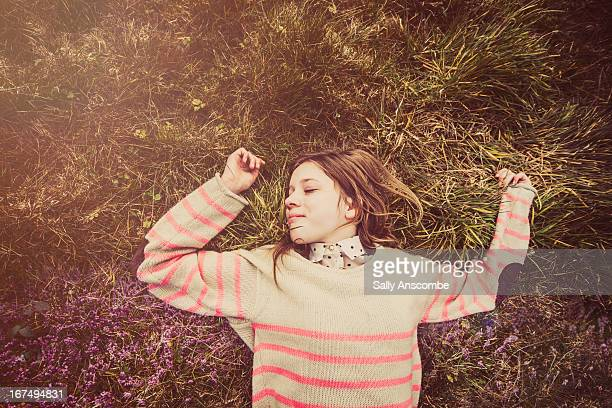 Young smiling girl relaxing outdoors