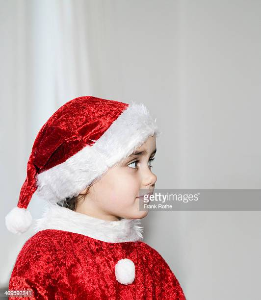young smiling girl with christmas costume