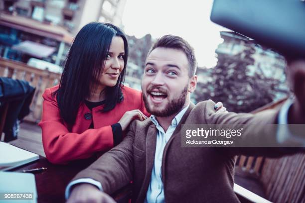 Young Smiling Life Insurance Agents Taking Selfie on Balcony and Drink Coffee