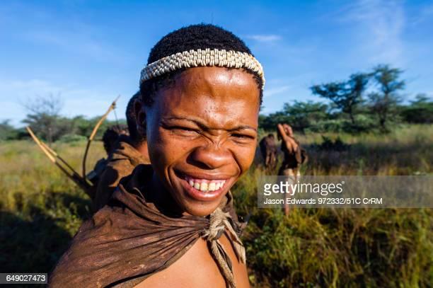 A young smiling San Bushmen wearing an Ostrich egg shell head band